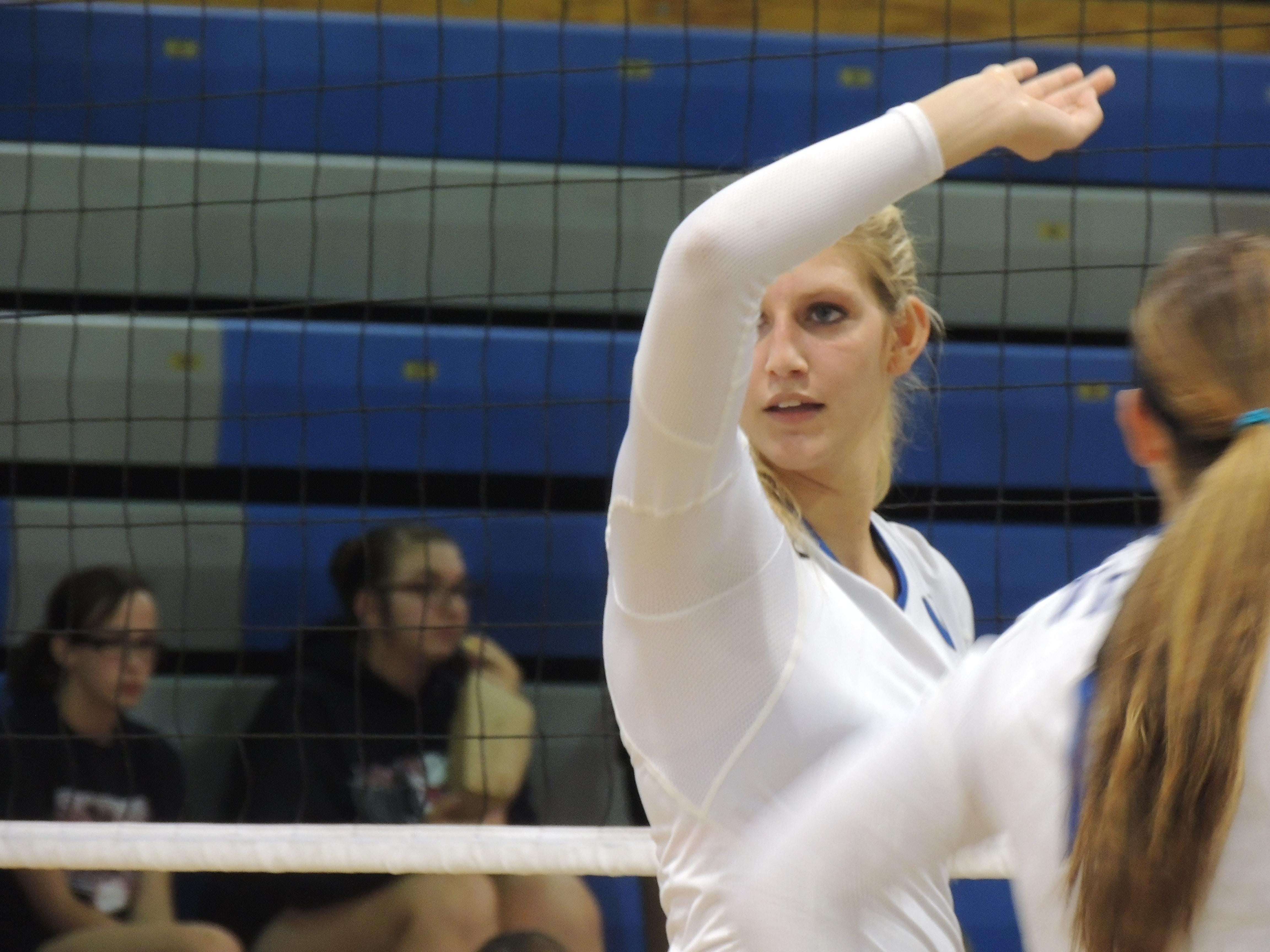 Wynford senior Alyssa Harrer waits for a serve from a teammate at the net.