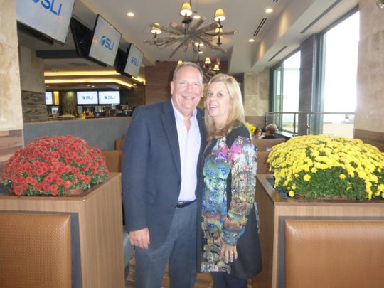 Farmington Hills residents Ron and Linda Hatfield are one of the first patrons to enjoy the new Emagine Palladium and Ironwood Grill in Birmingham.