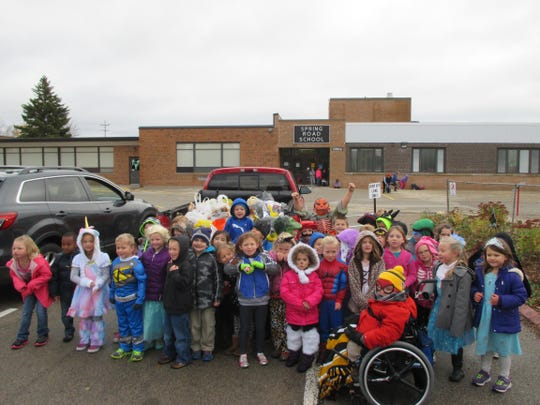 "Spring Road Elementary School kindergarten students held their third annual ""Trick or Treat for the Needy"" on Oct. 29, as they donned costumes and collected more than 700 pounds of canned goods from residents in the school neighborhood. Food was donated to St. Joseph's Food Pantry."