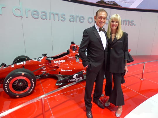 Bloomfield Hills residents Dr. Dan Haddad and his wife, Janet, checked out the Rahal Dallara Honda Indy Car. Janet opted for chic comfort and style in her Ellery Majesty pantsuit from Nordstrom's new designer collection, Space; and sparkly Miu Miu Mary Jane's.