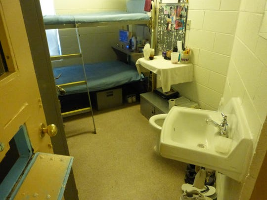 The inside of a prison cell at the Women's Huron Valley Correction Facility.