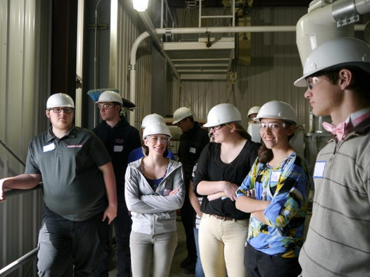Touring students from Great Falls and Twin Bridges get details on how grains are transported to and from Montana Milling on the plant's upper floors Monday.