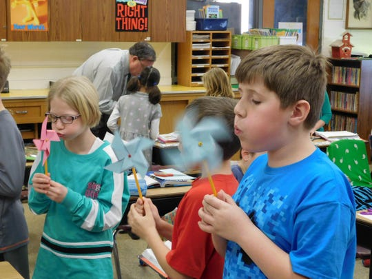 Martin Luther School's fourth-grade students Ava Rutkowski and Caleb Race made pinwheels to help them learn about how wind is a source of energy. They also learned that if they blew their pinwheels too long and too hard they would feel light-headed, and that it's very hard to blow on a pinwheel when laughing.