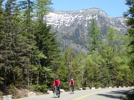 Bicyclists enjoy Going-to-the-Sun Road.