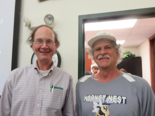 """Tom Seeley, left, and Mike Riter are shown June 14 at the Catskill Mountain Beekeepers Club in Cairo, where Seeley lectured to about 100 bee enthusiasts on his new book, """"Following the Wild Bees."""""""