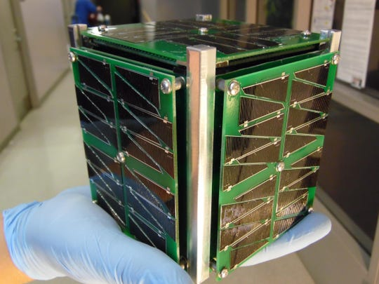 The CubeSat satellite weighs only a few pounds and can fit in the palm of your hand.