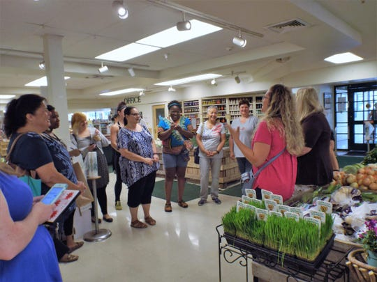 Certified dietitian nutritionist Jodi Darling, of Wappingers Falls, far right, speaks with the BetterU participants about heart-healthy food shopping at Adams Fairacre Farms in Poughkeepsie.