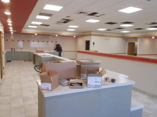 Construction crews remodel the New Peking Restaurant last year to convert it into the now-open westside Best Wok.