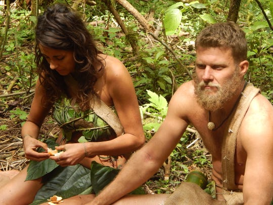 """Indialantic resident Adam Young and his teammate, Jaclyn McCaffrey, eat mandarins in Nicaragua during a July 2014 episode of Discovery Channel's """"Naked and Afraid."""""""