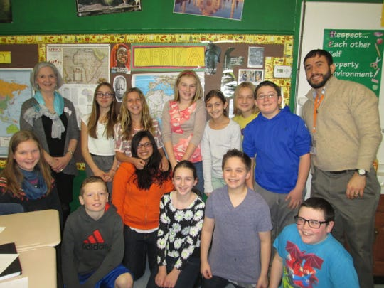 Sixth-grade social studies teacher James Savakis at Woodglen School in Lebanon Township had a special visitor come to visit his classes recently. Dr. Kathleen Malu, one of Savakis' professors from William Paterson University, came to talk to the students about her travels in Africa. Malu brought artifacts and media from five different African countries that she had visited. Sixth-grade students had the opportunity to handle the objects she brought and see pictures of her travels. Pictured, lef to right, front row, are: Lillian Mikulski, Brian Glass, Stephanie Herrera-Monteiro, Emalina Ascenzo, Owen Tabor, and Christian Palmisano; back row are Dr. Malu, Lily Kasulanis, Tess Rodenberger, Courtney Bresler, Grace Trumpy, Gabriel Meyer, Will O'Brien, and James Savakis.Staff and students hope Malu can come back soon to share more of her knowledge and her experience traveling around the world.