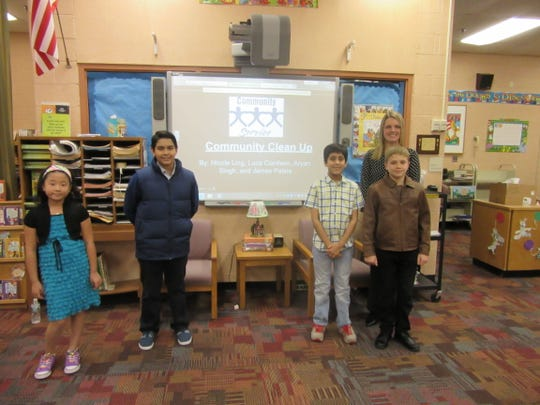 Angelo L. Tomaso School fifth-grade students, left to right, Nicole Ling, Luca Cianfano, Aryan Singh, and James Palaia, with their teacher, Michelle Jarmicki, presented their idea for a new club at the school in Warren to Board of Education members.