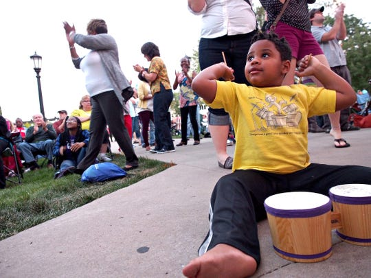 Maddox Schwalm-Bell, 4, of Iowa City jams on a tiny