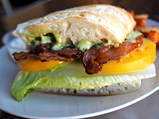 """Bacon sandwich """"The Bacon"""" photographed at NoDo Restaurant downtown on Oct. 21, 2014."""