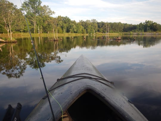 A fisherman's view from a kayak. The small paddle- or peddle-powered craft provide access to waters — and fish — beyond the reach of larger rigs.