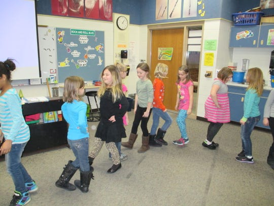 Second-grade students enjoy performing a German Valentine dance in Lisa Carroll's music classroom at Grant Elementary School.