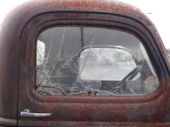 Some of the windows are broken on the 1941 Chevy pickup that parked in front of the Fussy Duck on Commercial Street SE, including the passenger's side, which has rows of clear tape covering it.