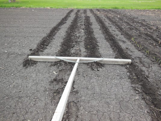One way to make rows in the garden is a tool like this but it can be difficu.jpg