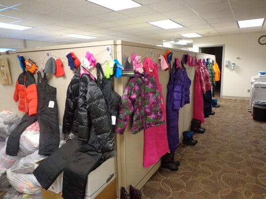 Winter wear lines a hallway at the DCE Administration Building. Staff members purchased outdoor items for children and donated gently used clothing and books for Rebecca's Closet, Career Closet and Ready to Read as part of a United Way drive.