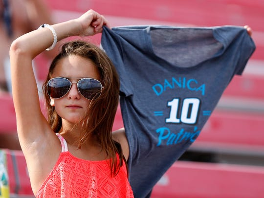 A fan roots for Danica Patrick, driver of the #10 Code 3 Associates Ford, during the Monster Energy NASCAR Cup Series Pure Michigan 400 at Michigan International Speedway on August 13, 2017 in Brooklyn, Michigan.