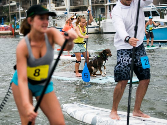Allison DeNunzio, center, and her dog, Barley, paddle
