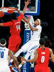 Memphis forward Jimario Rivers (right) completes an