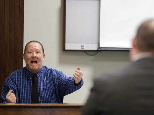 George Burch becomes animated while responding to a question  from Brown County district attorney David Lasee during Burch's testimony in his trial for the May 2016 murder of Nicole Vanderheyden.