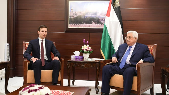 A handout photo made available by the Palestinian president's office show  Palestinian President Mahmoud Abbas, right, meeting with Jared Kushner, the White House adviser and President Trump's son-in-law in the West Bank town of Ramallah, on Aug. 24, 2017.