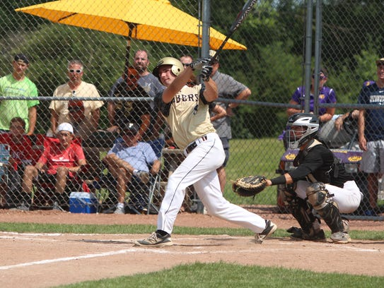 Nathan Aide of Franklin follows through on a home run