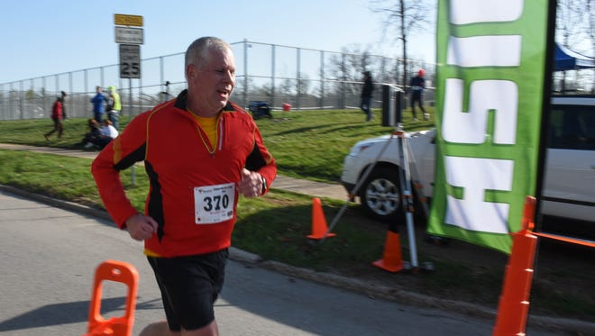 Curt Gause of Pleasant Hill finishes the 10k during the Springtime Hill Climb in Pleasant Hill on April 11, 2015.