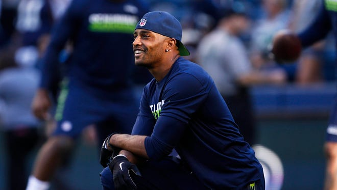 Seattle Seahawks wide receiver Doug Baldwin (89) watches teammates pre game warmups against the Dallas Cowboys at CenturyLink Field.
