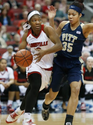 Louiville's Myisha Hines-Allen droves the baseline against Pitt's Stasha Carey. Feb. 28, 2016