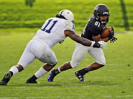 Northwestern wide receiver Jelani Roberts (81) runs against Penn State linebacker Brandon Bell (11) during the first quarter of an NCAA college football game against Northwestern in Evanston, Ill.,  Saturday, Nov. 7, 2015. (AP Photo/Matt Marton)