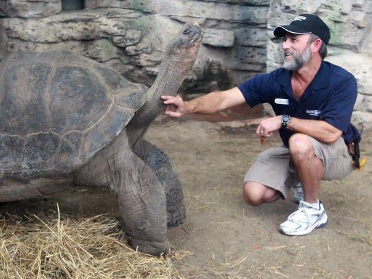 Ric Urban, animal ambassador at Newport Aquarium, scratches