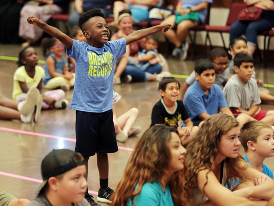 Marc Washington, 5, gets excited during a performance by magician Tommy 'Terrific' Diaz at the public library in Southaven Tuesday afternoon to kick off the children's summer reading program.