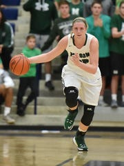 Samantha Puisis pushes the ball down the floor.