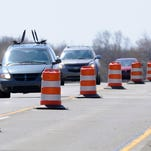 Traffic on Grand River Avenue in East Lansing near Harrison Road is down to one lane in this file photo. State, county and local agencies are getting ready for a new wave of road projects in 2015.