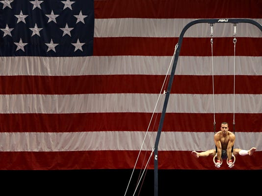 Daniel Leyva works out on the rings during a practice session for the men's gymnastics 2016 U.S. Olympic Trials at the Chaifetz Arena Wednesday, June 22, 2016, in St. Louis. (David Carson/St. Louis Post-Dispatch via AP)  EDWARDSVILLE INTELLIGENCER OUT; THE ALTON TELEGRAPH OUT; MANDATORY CREDIT