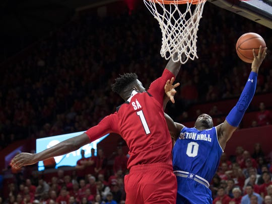 Rutgers' Candido Sa blocks shot by Seton Hall's Khadeen