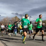 Runners begin the 4th annual Shamrock Shuffle 5k put on by Crawl Reno on Saturday, March 5 in Sparks.