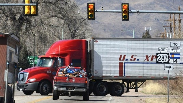A south-bound semi turns left at the LaPorte bypass at the on Hwy 287 Thursday March 20, 2014. A $36 million project to widen U.S. 287 north of Fort Collins is expected to go to bid this summer.