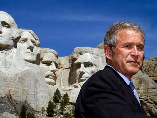 President Bush pauses as he speaks about homeland security and the budget at the base of Mount Rushmore National Memorial, in background, Thursday, Aug. 15, 2002, in S.D. (AP Photo/Ken Lambert)