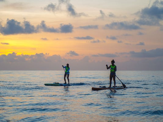 ADJ-CROSSING--Paddlers-at-dawn.jpg