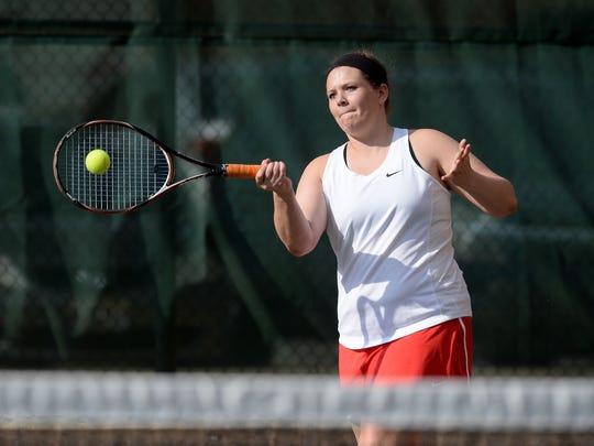 Richmond's Anna Creech returns the ball while playing