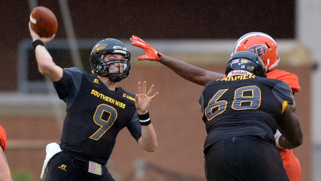 Southern Miss quarterback Nick Mullens throws a pass Saturday during a rainy game against UTEP at M.M. Roberts Stadium.