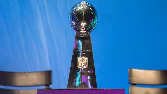 The Vince Lombardi Trophy sits on display at the Super Bowl Opening Night Monday at the Xcel Energy Center.