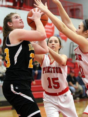 Paint Valley's Lexi Woods looks to shoot over Piketon's Ally Crothers and Gracie Lightle this past Thursday at Piketon High School. Woods is averaging 26.5 points per game over her last six contests.