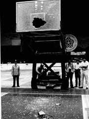 Monroe's Tim Harvey brought down the rim during Class AA Section 5 game at the Community War Memorial. The broken backboard stopped the game.  (Jim Laragy photo, 3/3/1981)