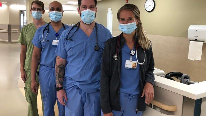Members of the UR/St. James Hospital medical team, front to back, Anna Cappadonia, physician assistant; Matt Walton, physician assistant; Dr. Sachin Manthuruthil, hospitalist; and Kurt Zeltwanger, RN.