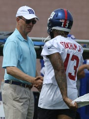 Owner John Mara and Odell Beckham Jr. greet each other
