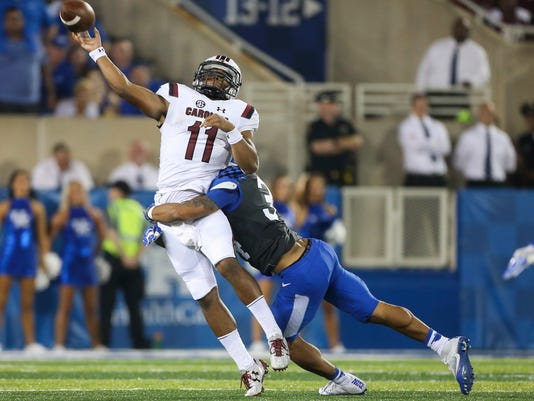 South Carolina quarterback Brandon McIlwain gets off a pass as he is hit by Kentucky linebacker Jordan Jones in the second half of an NCAA college football game Saturday, Sept. 24, 2016, in Lexington, Ky. Kentucky won the game 17-10. (AP Photo/David Stephenson)